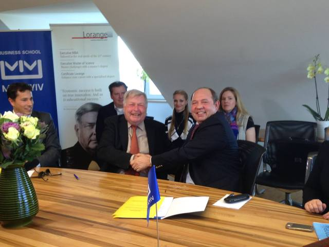 MIM president Dr. Vitaly Gayduk and Peter Lorange signing the cooperation